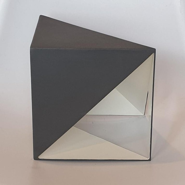 Steel 79 is a unique small size contemporary modern abstract sculpture by Dutch artist Carl Möller. This work explores the effect of adding and deleting diagonal planes in a perfect steel cube of 20x20x20 cm. In doing so, the artist creates open