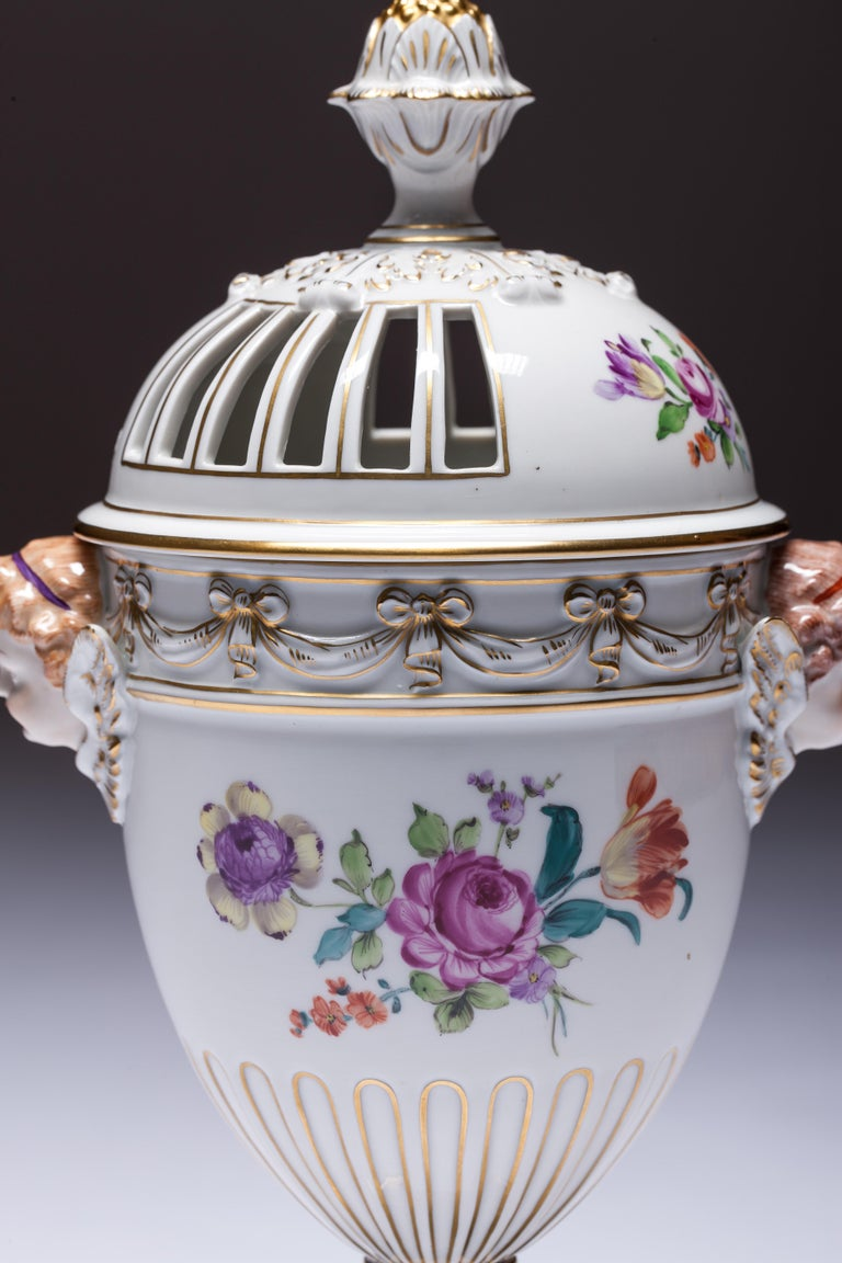 Dresden Porcelain pot pourri vase by Carl Thieme, circa 1900. Neoclassical urn shape, set on a round pedestal on square socle base, the lower body is fluted, then steps out for the main body and back in again to matching fluting on the shoulders.