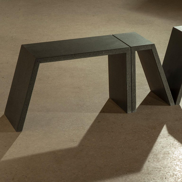This refined contemporary coffee table fashioned of lava stone comprises modular elements that, together, create a geometric and elegant Silhouette. With an appearance that is at the same time light and playful, this piece is an easy addition to any