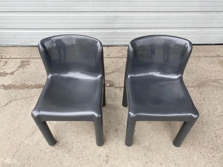 Early pair of Italian Modernist Polypropylene chairs designed by Carlo Bartoli for Kartell Italia in the 1970s model 4875, unusual color, art furniture, Nice original condition, minor scratches, scuffs, age appropriate wear.