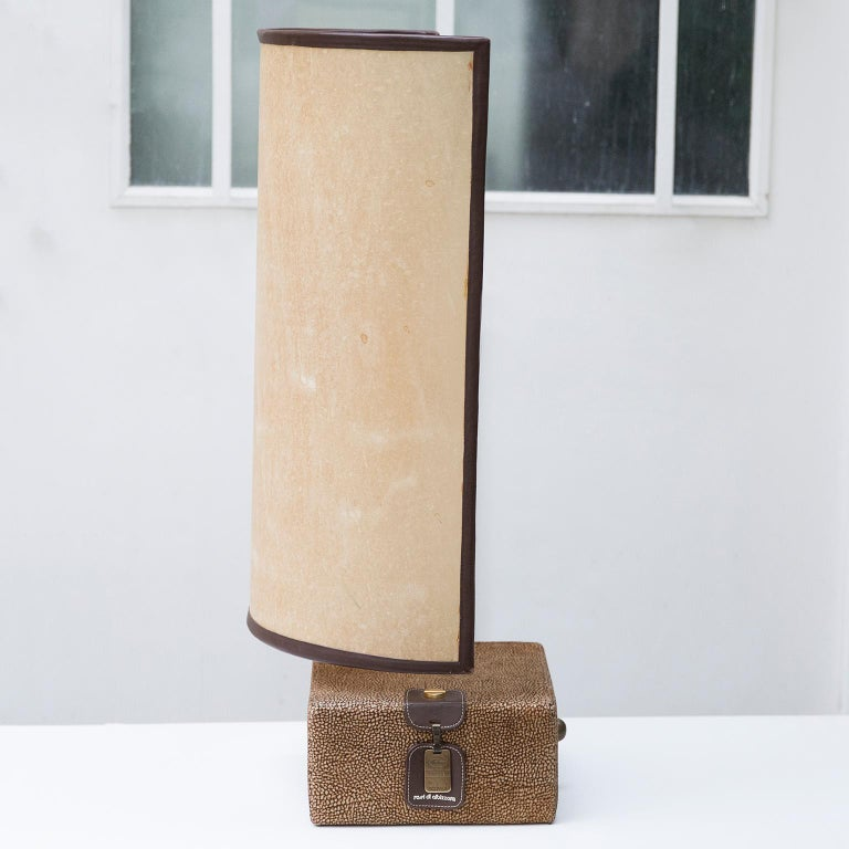 Very elegant suede table lamp with a leather faced parchment shade from the 1980s, BOGO collection of Rossi di Albizzate, designed by Carlo Bartoli.