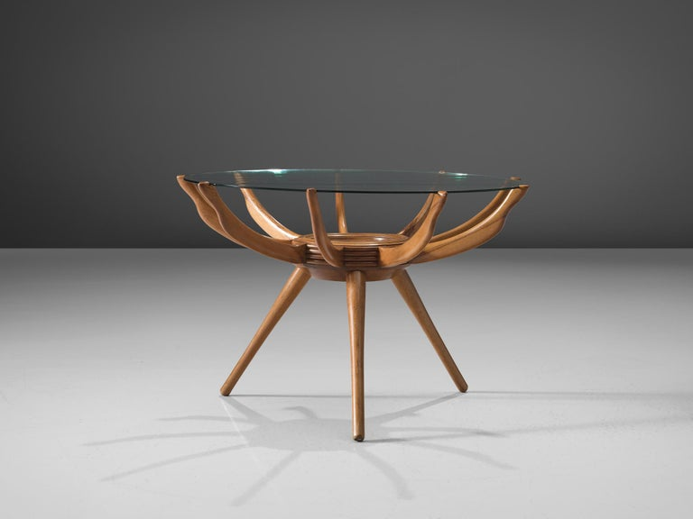 Carlo de Carli, Renato G. Angeli, and Luigi Claudio Olivier, coffee table, beech, glass, Italy, 1950s.  This coffee table bis made out of beechwood and glass. The tabletop is gently placed on the wooden arms which connect to the three legs of the