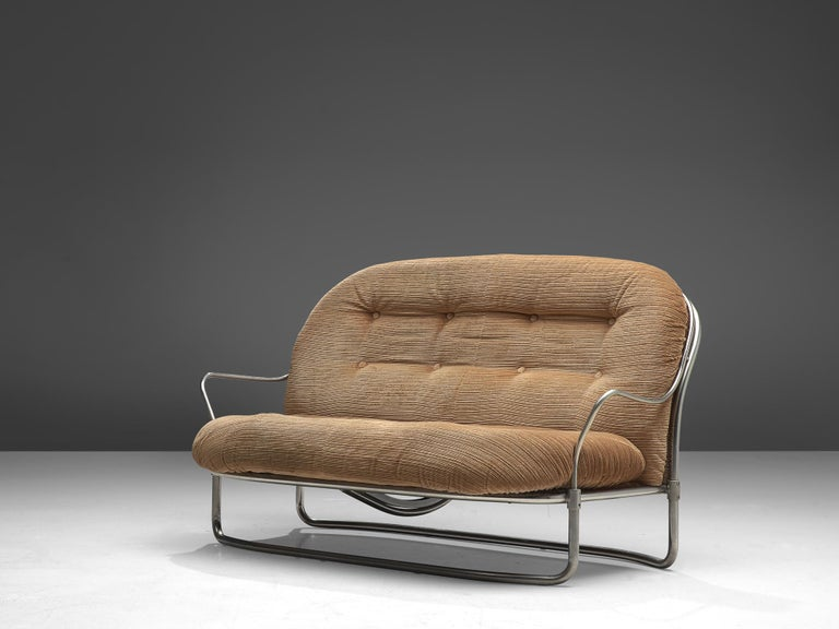 Carlo de Carli for Cinova, sofa No. 915, metal and fabric, Italy, 1969.  Elegant, tubular settee designed by Carlo de Carli in 1969 and manufactured by Cinova/Italy. The model features a curved, nickled-plated frame that holds the large, tufted