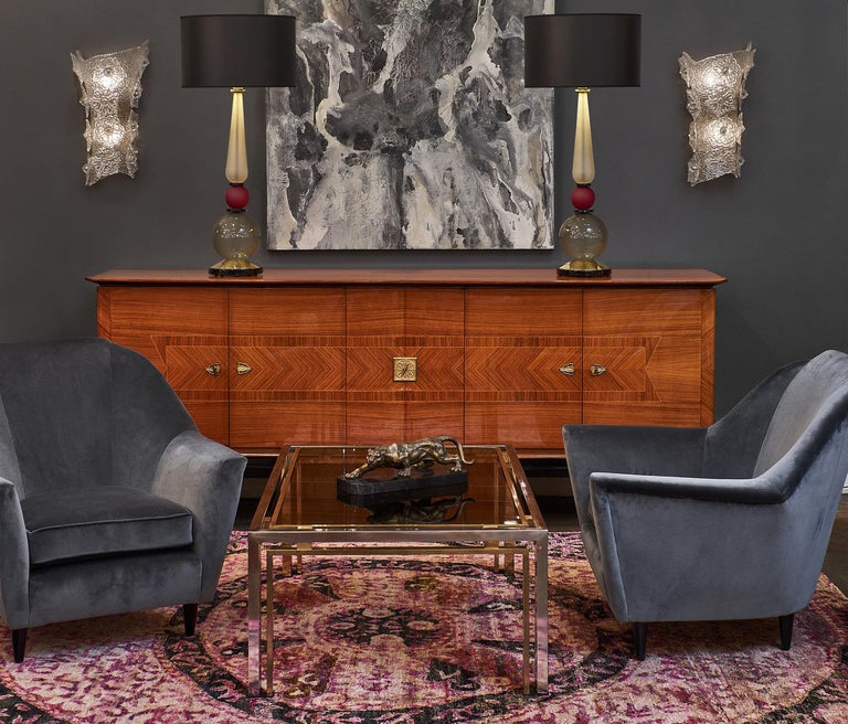 Pair of sumptuous Italian velvet armchairs by Carlo di Carli with ebonized wooden feet. This pair has been newly reupholstered with dark grey cotton velvet. The armchairs are very deep and comfortable.