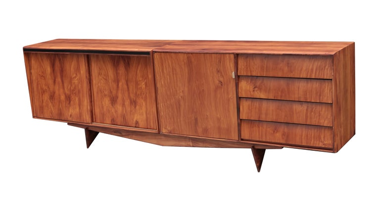 Carlo Hauner and Martin Eisler designed Brazilian midcentury sideboard. Rosewood with two siding doors, four drawers and one traditional door with brass pull.