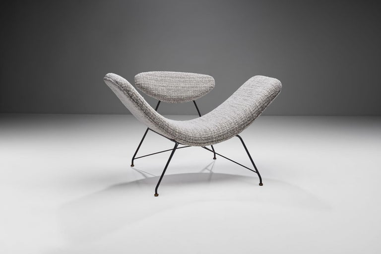 "This ""Reversivel"" (Reversible) chair is without a doubt a Brazilian design icon. It is considered to be one of the most emblematic armchairs of Brazilian modern design. Martin Eisler designed this sculptural armchair in 1955.