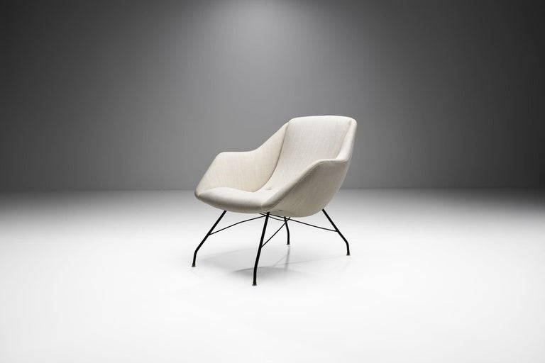 """""""Shell"""" lounge chair designed by Carlo Hauner and Martin Eisler, circa 1955. The frame is made of black painted iron. The upholstery is in a light linen blend fabric. Due the diagonal lines and the thinness of the frame, the shell has an almost"""
