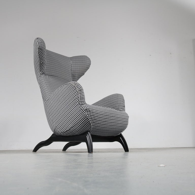 """A beautiful highback lounge chair, model """"Ardea"""", designed by Carlo Mollino and manufactured by Zanotta in Italy, circa 1980.  This eye-catching chair has a fantastic dog tooth pattern fabric in black and white, which greatly contributes to the"""
