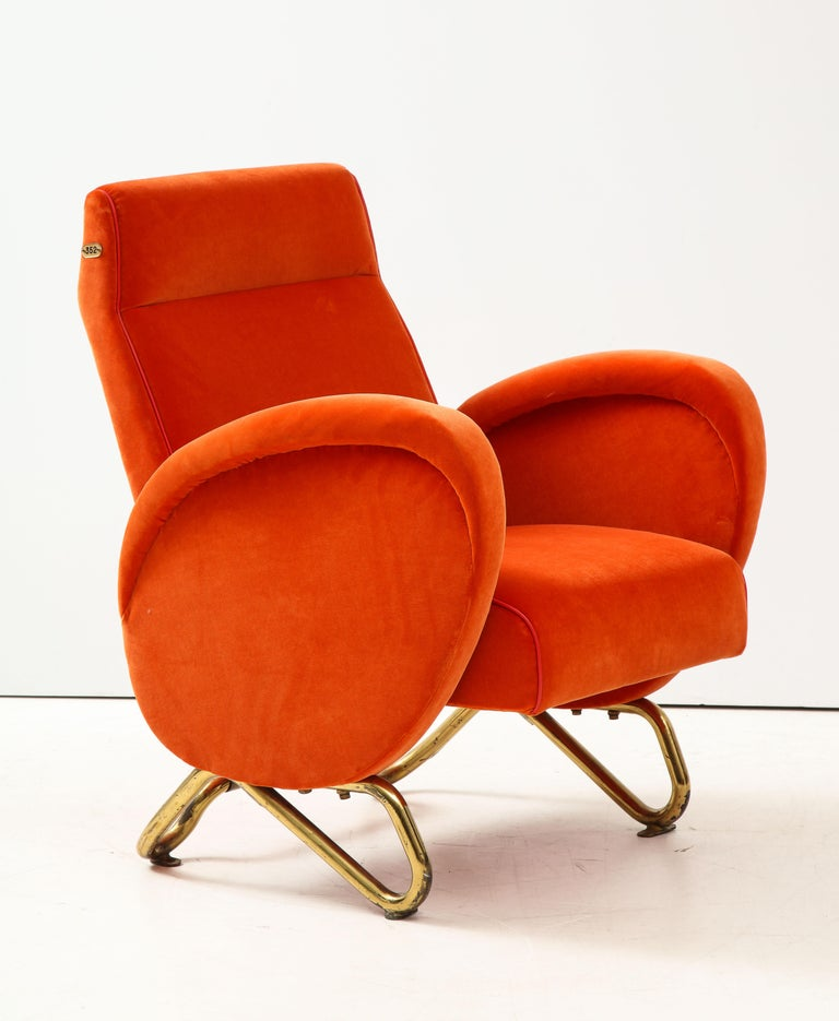 Extremely rare and exceptional brass and velvet armchair by Carlo Mollino, Turin, Italy, c. 1951.  This armchair was originally made for the important Radio Audizioni Italiane (RAI) Auditorium in Turin, a historic commission for acclaimed architect