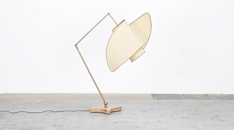 The design for this adjustable floor lamp was created by Carlo Mollino in 1947. This re-edition was made in 2016 by Galleria Colombari. Parchment shade supported by brass arm on polished marble base. The lamp is able to swivel 360 degrees by