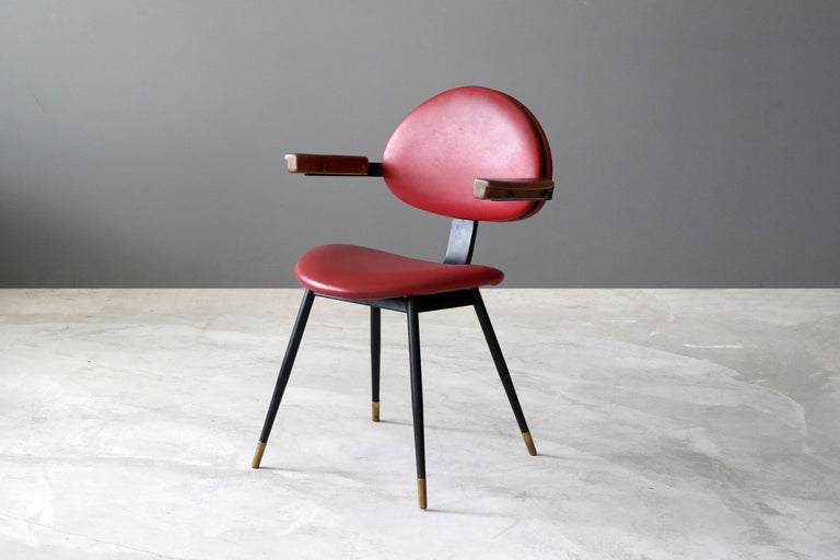 A rare side chair designed by Carlo Mollino for the Lutrario ballroom, Turin, Italy, in 1959. In painted tubular iron, painted iron, Resinflex, oak. Produced by Doro.  Fulvio Ferrari, the leading expert on Carlo Mollino, described the Lutrario
