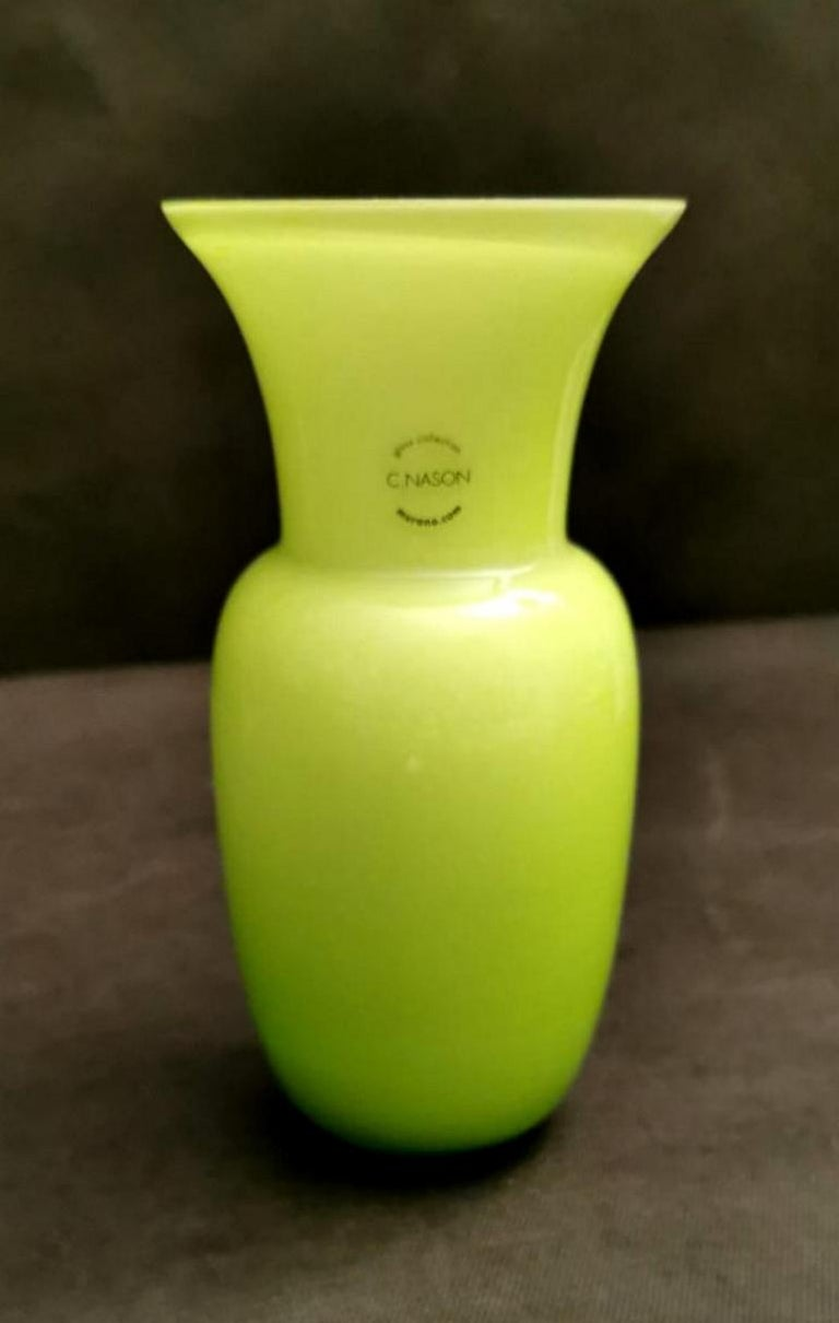 Lemon-green glass vase and white interior; the design is linear and simple but very proportioned and elegant; the lemon-green shade is also pleasant. Produced in Murano by the company C.Nason between 1980 and 1985. The vase is signed on the bottom.