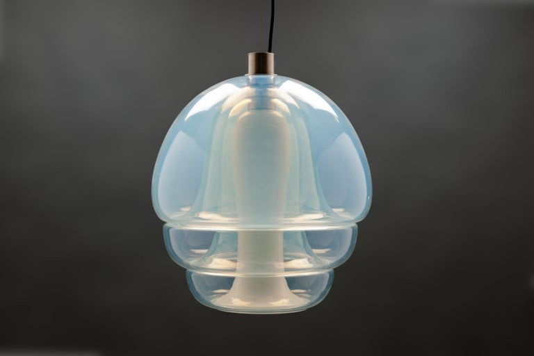 Pendant model LS 134 by Italian designer Carlo Nason, designed in 1969 and executed by Mazzega Murano, Italy. Pendant consisting of four interlocking opalescent mouth blown glass parts.  This is a rare and spectacular enchanting light fixture that