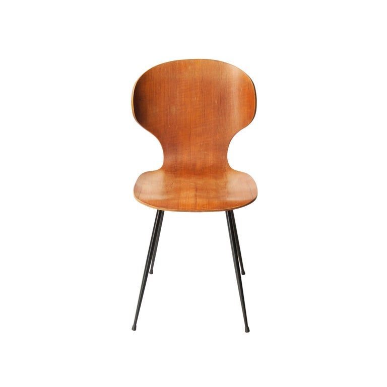 Set of six chairs designed by Carlo Ratti. Black lacquered metallic structure, seat and back in teak wood.