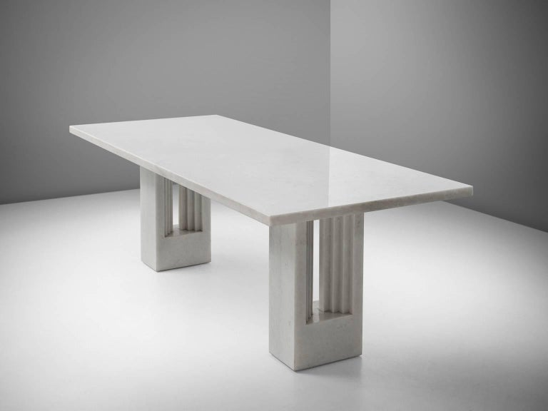 Carlo Scarpa and Marcel Breuer, dining table'Delfi', marble, by Italy 1970.   Beautiful white colored marble table by Italian designer Carlo Scarpa. This center table is very stately. The legs with gradual lines remind of classical roman columns and