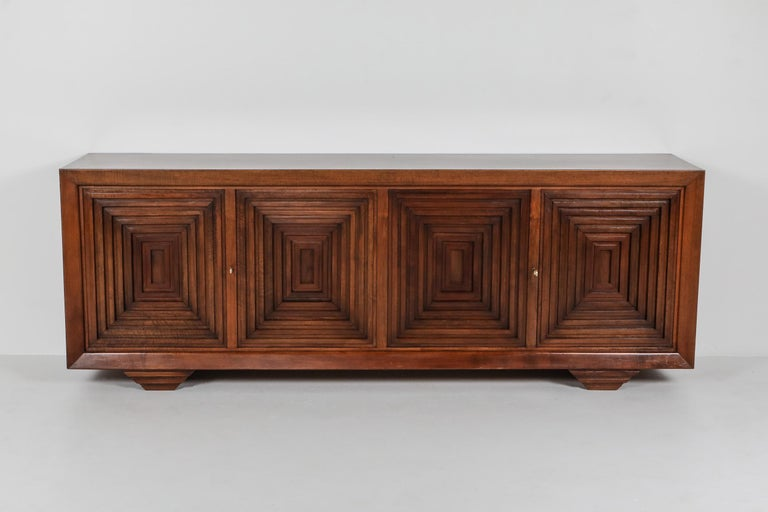 Carlo Scarpa, sideboard, solid walnut and walnut veneer, mid-century modern, brutalist  Similar to his architectural masterpiece, the Brion Vega cemetery, he uses graphical lines and contrasting depths into his work, like a never-ending