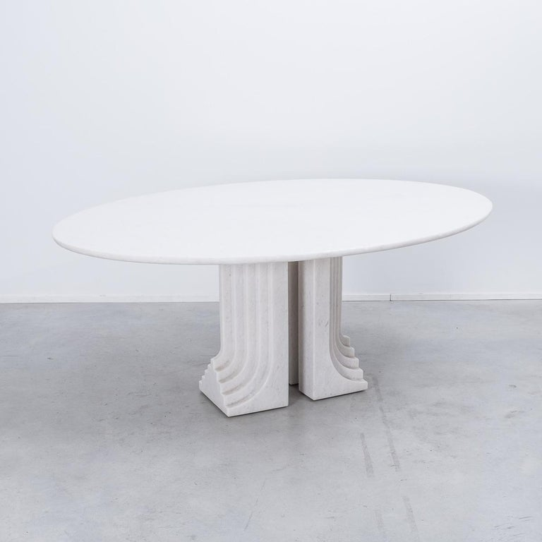 Carlo Scarpa 'Samo' table, produced by Simon, Italy 1970s. Part of the 'Ultrarazionale' collection by Simon, the base is formed of two pillars of Naxos marble, layered like map contours in relief. The oval tabletop floats of this marble monolith. At