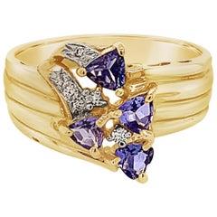 Carlo Viani Ring with Tanzanite, Vanilla Diamonds Set in 14 Karat Honey Gold
