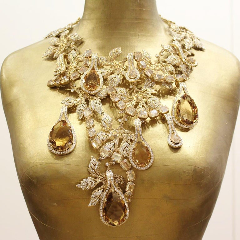 Fantastic masterpiece by Carlo Zini One of the world greatest bijoux designers Large collier, completely handmade Magnificent construction on swarovski crystals and champagne tailor cut glasses Zyrcons 100% Artisanal work made in Milano Piece with