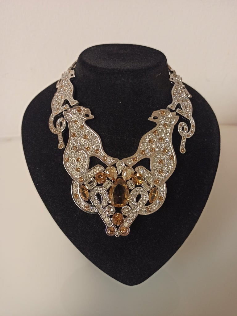 Fantastic piece by Carlo Zini One of the world greatest bijoux designers Non allergenic rhodium Amazing hand application of swarovski crystals Champagne/amber cut crystals 100% Artisanal work Made in Milano Worldwide express shipping included in the