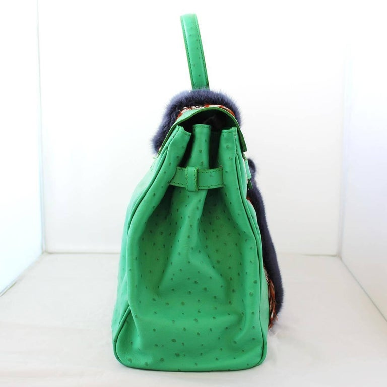 Different and very chic bag by Carlo Zini Ostrich printed leather Green color Blue mink Real plumage Single handle Two internal compartments Zip divisory Internal zip pocket Cm 38 x 28 x 16 (14.9 x 11  x 6.2 inches) Worldwide express shipping