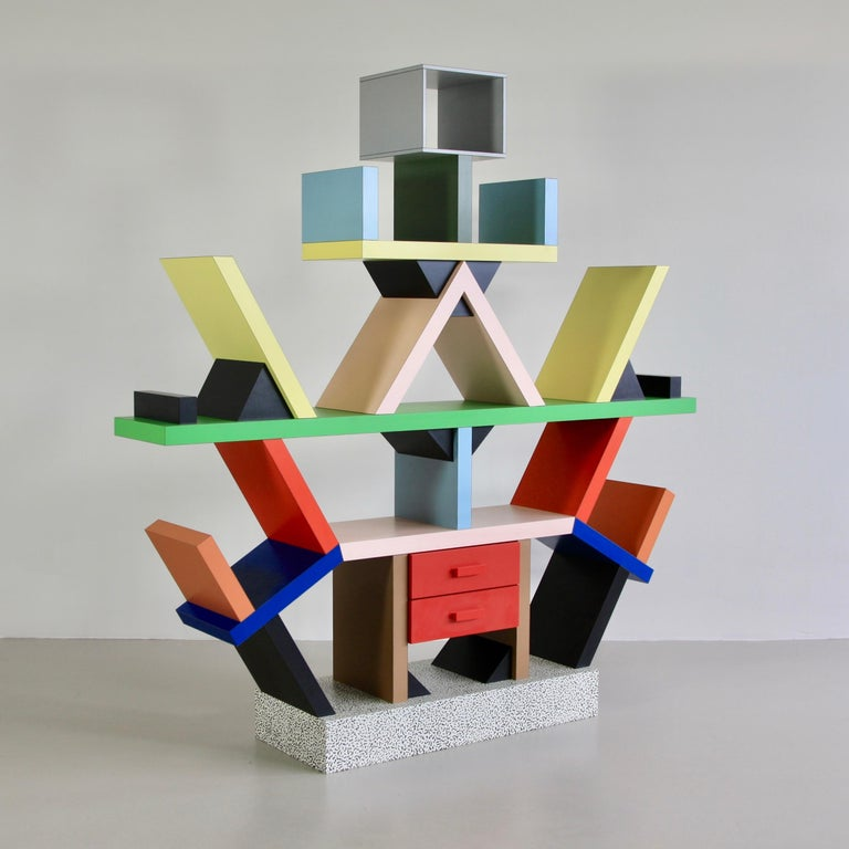 The Carlton bookcase and room divider, designed by Ettore Sottsass in 1981, Italy.  Wood and plastic laminate construction in an array of colors.  Literature:  Collection Museum of Modern Art, New York.  Repertorio del Design Italiano, 2