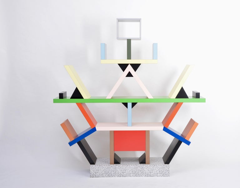 Carlton Room Divider Designed by Ettore Sottsass in 1981 for Memphis Milano The totemic Carlton room divider is a Memphis icon. The piece calls into question conventional furniture forms by combining a space divider, bookcase, and chest of drawers.