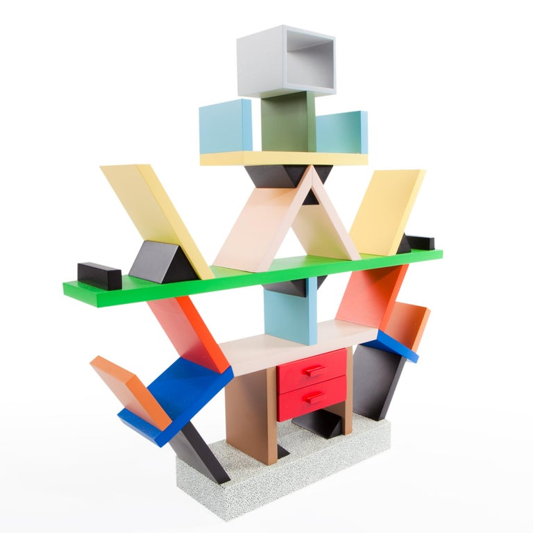 Here you are shown an authentic and perfect reproduction of the Carlton bookcase and room divider, originally designed in 1981 by Ettore Sottsass. The vivid colors and seemingly random interplay of solids and voids, suggest Avant Garde painting and