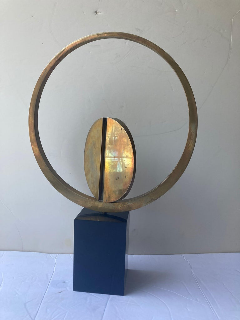 Traditional style sculpture for the well known Italian artist Carmelo Cappello. This is signed and dated 37/99 and 1978. The work shows patina of age and the work seats lose on the base. As kinetic.