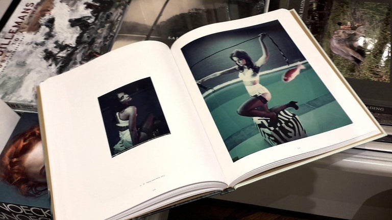 'The Eyes of the Fox' book signed including 'Miss Eris', Edition of 3 - Beige Color Photograph by Carmen de Vos