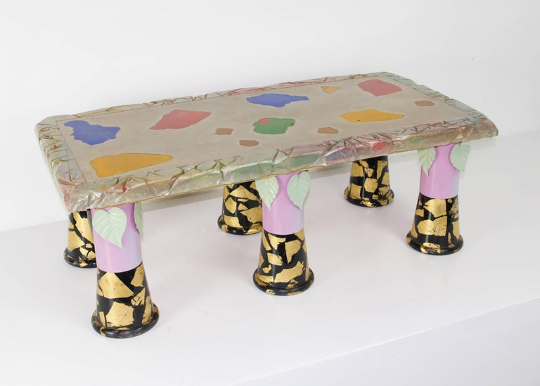 New to market, and previously unseen table by Carmen Spera, an important figure in the Downtown NYC art furniture scene as fostered by Art et Industrie. It features six painted and adorned metal legs supporting a substantial multi-textured cement
