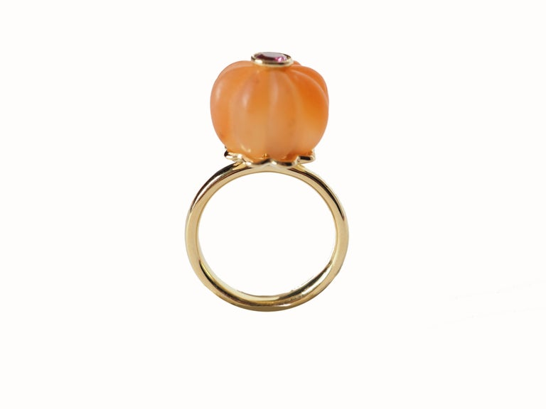 Carnelian pumpkins shape with pink tourmaline in the center 18k gold gr.6,40 size 14 eu. Very nice also if you want to we are in couple with the other color available. All Giulia Colussi jewelry is new and has never been previously owned or worn.