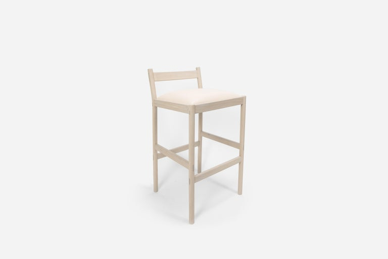 Sun at six is a Brooklyn design studio. We work with traditional Chinese joinery masters to handcraft our pieces using traditional joinery. This minimal bar stool combines clean lines with quality material: solid white oak and vegetable tanned