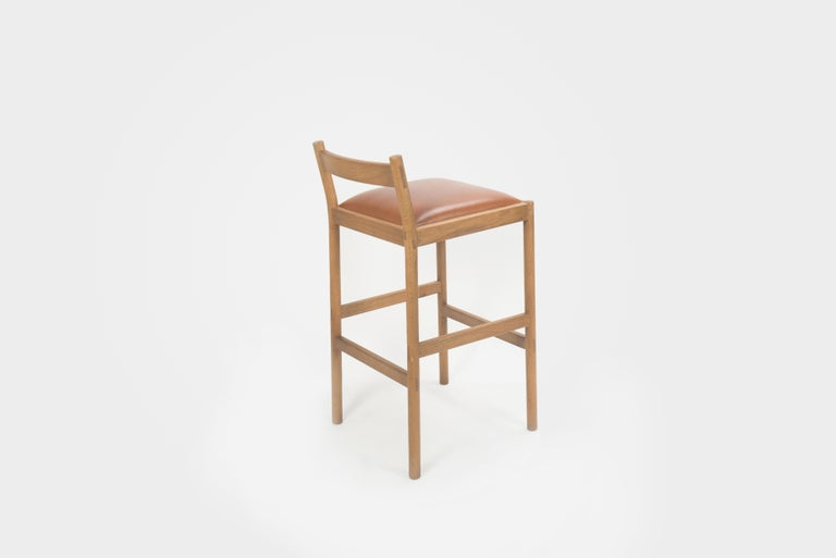 Chinese Carob Bar Stool by Sun at Six, Sienna Minimalist Stool in Oak Wood and Leather For Sale