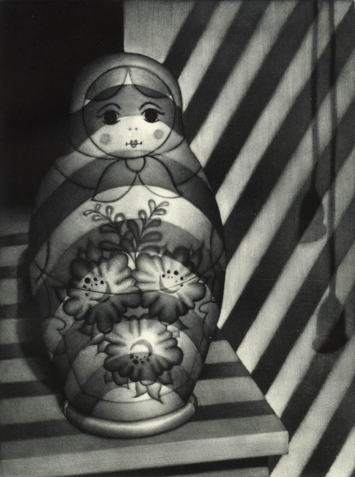 Venetian Blinds Russian Doll (Matryoshka resting dolls with light from blinds)