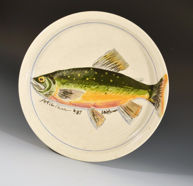 Carole Moses Harman ceramic dishes painted with fish,  Arctic Char & Ouananiche Salmon Dated June 1987.  Two large pottery dishes hand painted with an Arctic Char & an Ouananiche Salmon.  Dated 6/87.