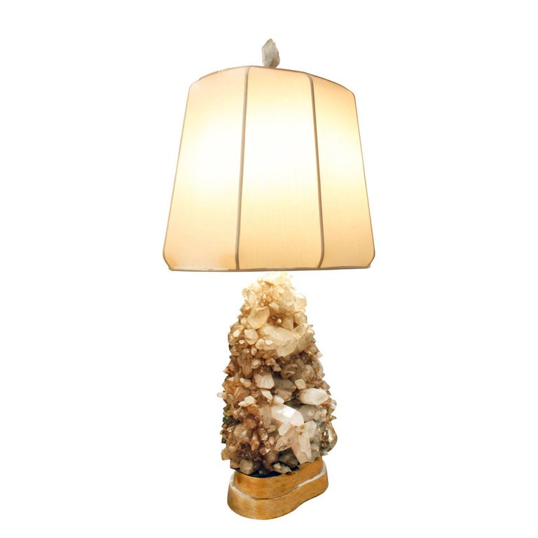 Large studio made table lamp clad in quartz crystals with gilded base and original crystal finial by Carole Stupell, American, 1950s.