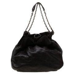 Carolina Herrera Dark Brown Monogram Embossed Leather Bow Bucket Shoulder Bag