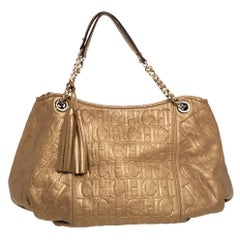 Carolina Herrera Golden Brown Monogram Embossed Leather Tassel Hobo