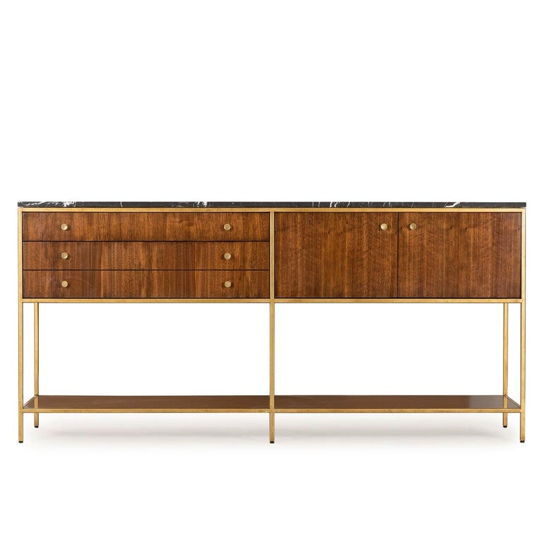 Sideboard Carolina with structure in metal in brass finish with solid oak and walnut structure. With black marquina marble top. Sideboard including 3 drawers and two doors.