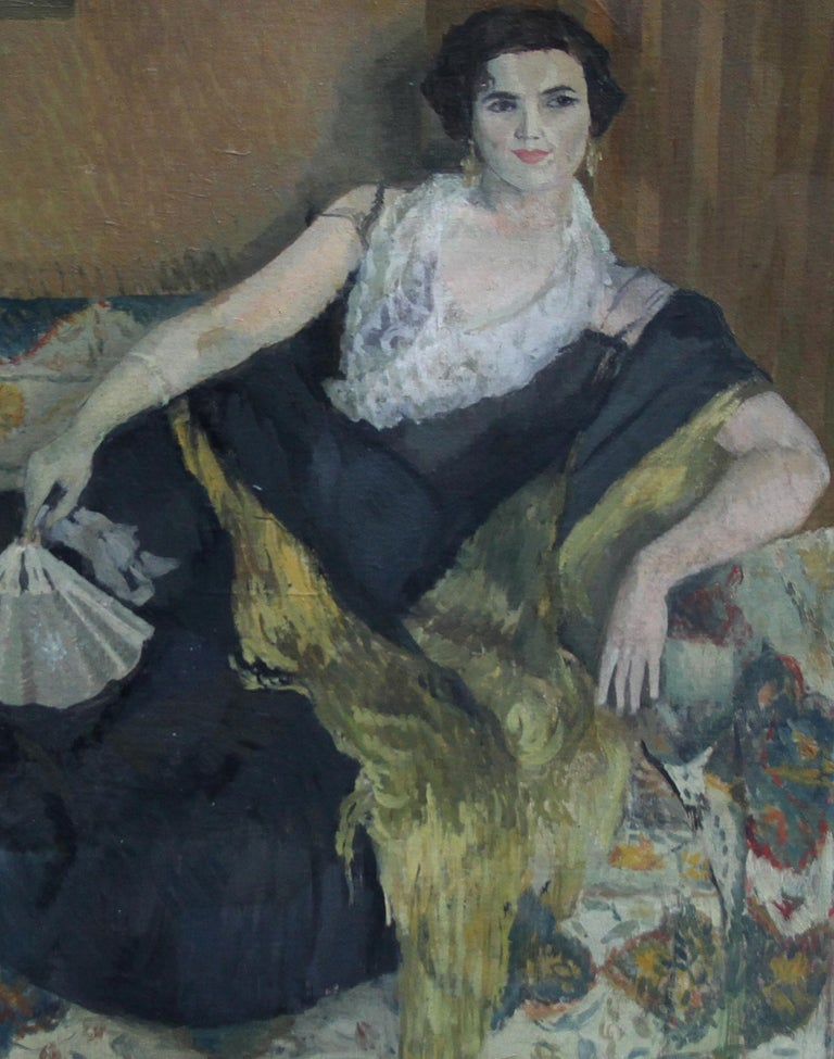 This large oil on canvas portrait was painted by Caroline Hutchinson circa 1955. It depicts a lady reclining on a sofa and is painted in an Impressionist palette and manner. A beautiful portrait with fantastic colouring and detail. Signed with