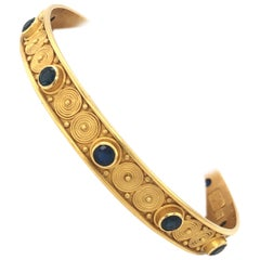 Carolyn Tyler Yellow Gold and Blue Sapphire Spiral Bangle