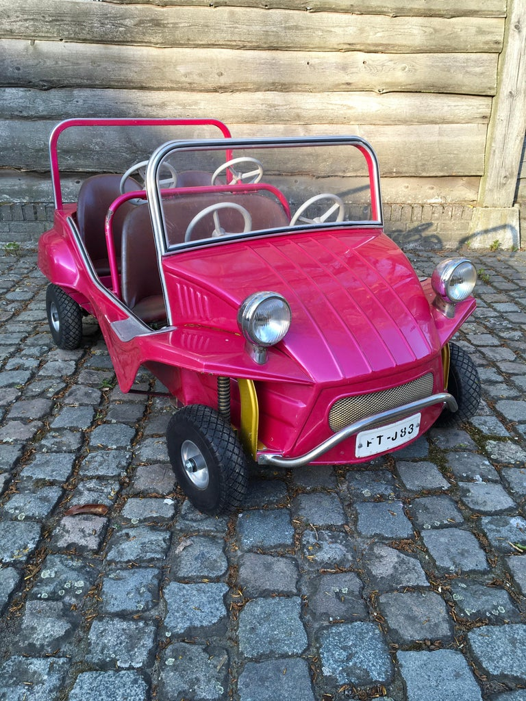 Pink Carousel Citroën Buggy Car by L'Autopède Belgium.  This sheet metal carnival ride car with 4 seats dates from the 1970s. It's a handmade piece with in the meantime the beautiful bright color pink what makes him so attractive!  This
