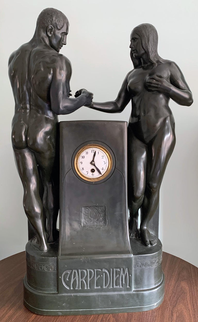 Extremely rare and beautifully sculpted and executed, this monumental terracotta clock depicting a nude Adam and Eve exchanging the fateful apple, is finished in a green-black glaze approximating the dark bronze patina preferred by Germans at the