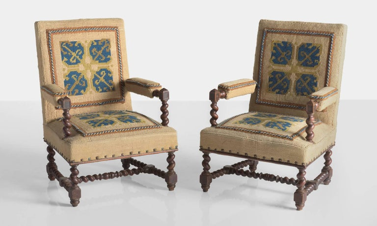 Carpet chairs, France, circa 1890  Unique pair of chairs upholstered in a thickly textured carpet-like material featuring a geometric woven motif. Includes elegantly turned oak arms and legs.  Measures: 15