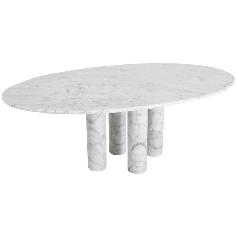 Cassina produced this Il Colonnata dining table by Mario Bellini in Italy 1977. A forest of massive primordial columns. The sensuality of marble celebrates the material, evoking the mysterious solemnity of Stonehenge.  Mario Bellini (1935-) is