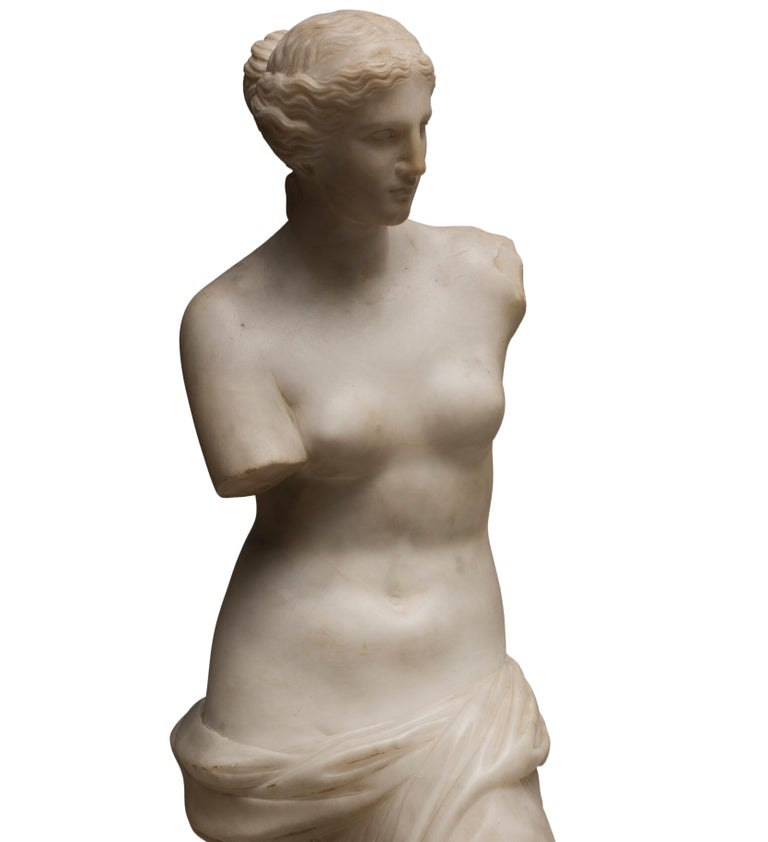 Venus de Milo is an original Carrara marble sculpture realized in 1820 by French sculptor manufacture.  The beautiful sculpture represents a copy of the famous Venus De Milo, the ancient statue commonly thought to represent Aphrodite, now in Paris