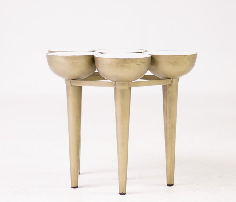 Unique side table composed of five torch shaped gold lacquered metal elements inserted with round Carrara marble tops. Great conversation piece!