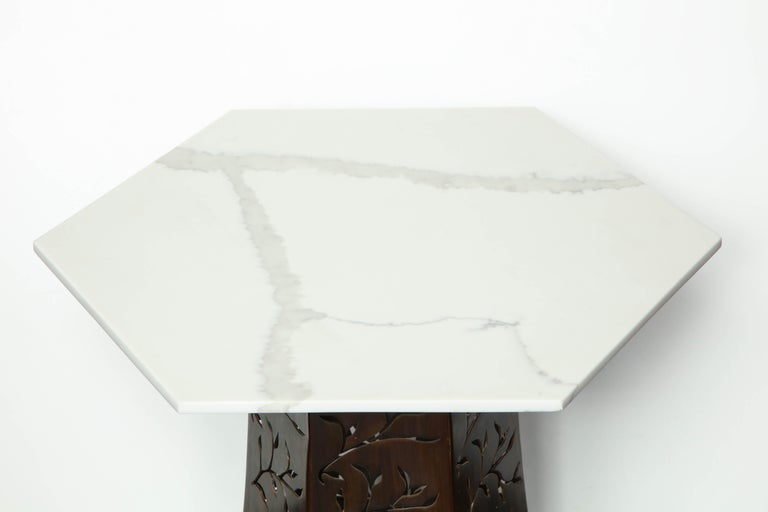 Carrara white marble with patinated blackened steel.