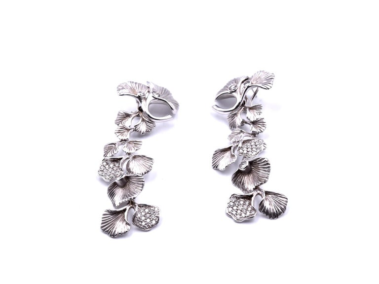 "Designer: Carrera y Carrera  Material: 14k white gold  Diamonds: 12.94cttw Color: G Clarity: VS Fastening: post with omega back on earrings Dimensions: earrings are approximately 3"" long and 25.60mm, bracelet is 7 ¼ inches long and 28.60mm wide,"